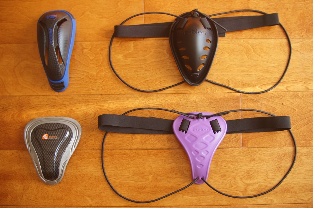 Top row left to right: RDX  gel groin cup, Lo-Bloo Thai Cup 2.0. Bottom row left to right: Shock Doctor Pelvic Protector, Lo-Bloo Aero Slim Female.